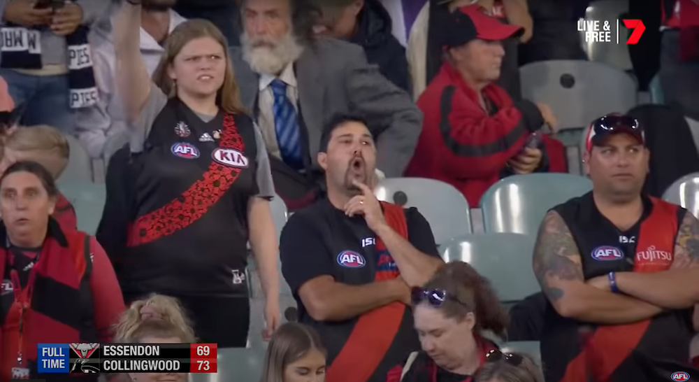 Still image of Essendon fans booing